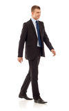 Young businessman is walking Royalty Free Stock Photo