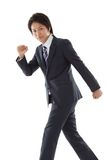 Young businessman is walking Royalty Free Stock Image