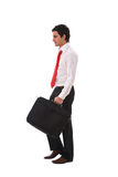 Young businessman walking Stock Photo