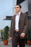 Young Businessman Walking. In front of glass office building Stock Photography