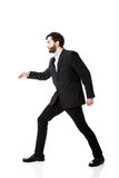 Young businessman walking carefully. Royalty Free Stock Images