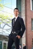 Young businessman walking in the city Royalty Free Stock Photo