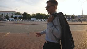 Young businessman walking at the city street and meeting his friend or colleague. Business handshake outdoor. Shaking of. Male arms outside. Men meet and shake stock video