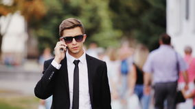 Young Businessman walking down the street stock footage