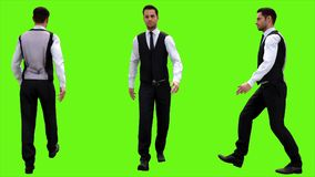 Young businessman walking on a green screen background. 3D rendering. Young businessman walking on a green screen background Stock Image