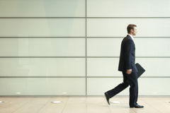 Young Businessman Walking In Passage Stock Images