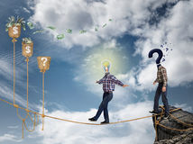 Young businessman walking on the rope Stock Image