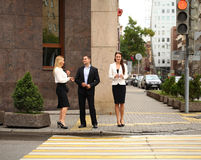 A young businessman walking on the street with their secretaries Stock Photography