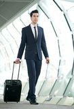Young businessman walking in subway station with bag Royalty Free Stock Image