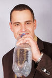Young businessman with water Stock Images