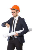 Young businessman wear a safety helmet looking at his watches Royalty Free Stock Photo