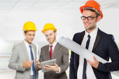 Young businessman wear a safety helmet Stock Photo