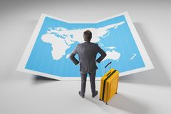 Businessman in suit looking at world map stock images