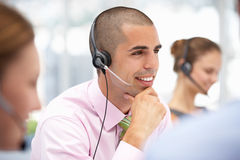 Young businessman wearing headset Royalty Free Stock Photography