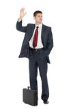 Young businessman with a welcoming gesture Stock Photo