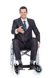 Young businessman in wheelchair. On white stock images