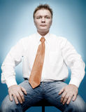 Young businessman in white shirt and orange tie Stock Image