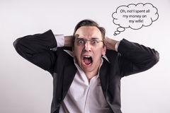 Young businessman who spent all his money on his wife screaming with rage and frustration Stock Photo
