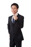 Young businessman with a wink and thumbs up Stock Photos