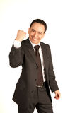 Young businessman with winning gesture Stock Photo