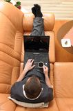 Young Businessman With A Laptop On The Couch Drink Royalty Free Stock Photography
