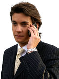 Young Businessman witha Mobile Phone. Young man in business suit with cellphone Stock Photos