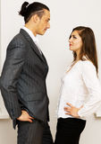 Young businessman and woman having an argument. In office royalty free stock photos