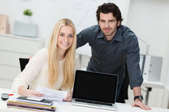 Young businessman and woman in the office royalty free stock photos