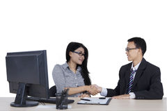 Young businessman and woman shaking hands Stock Image