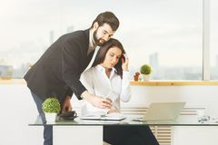 Young businessman and woman using cellular phone Stock Image