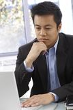 Young businessman working Stock Images