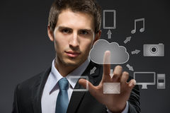 Young businessman working with cloud technology Stock Photos