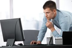 Young businessman working on computer Stock Photo