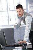 Young businessman working with computer Stock Image