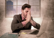 Young  businessman working on computer at office depressed and sad suffering headache Stock Image