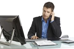 Young businessman working at desk Stock Photography