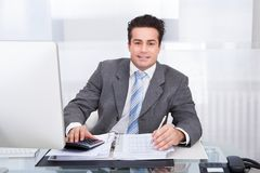 Young businessman working at desk Royalty Free Stock Photography