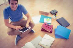 Young businessman working on the floor with tablet Royalty Free Stock Photos