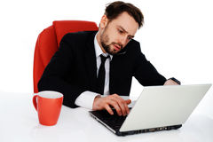 Young businessman working on his laptop Stock Photos