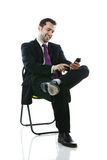 Young businessman working on his smartphone Royalty Free Stock Photography