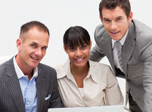 Young businessman working with his team. Young businessman and his team using a laptop Royalty Free Stock Image