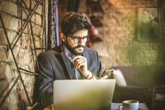 Young businessman working at home. Close up image of young businessman Royalty Free Stock Images