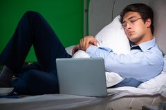 Young businessman under stress in the bedroom at night stock photos