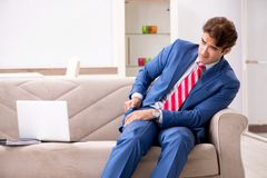 Young businessman working at home sitting on the sofa royalty free stock photo