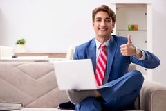Young businessman working at home sitting on the sofa stock image