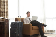 Young businessman working in the hotel room royalty free stock photo