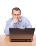Young businessman working at laptop Stock Photos
