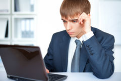 Young businessman working on laptop Royalty Free Stock Photography