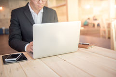 Young businessman working with laptop in cafe stock photography