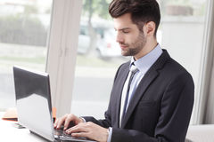 Young businessman working on laptop Royalty Free Stock Photo